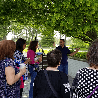 People listening to expert in courtyard at 3rd annual arboretum tour